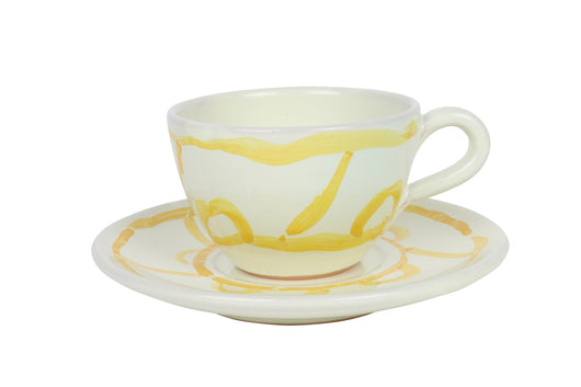 Tea cup and saucer, yellow