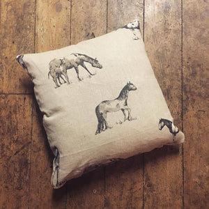 Horse Print Cushion by Feversham, featuring horses on a natural taupe background