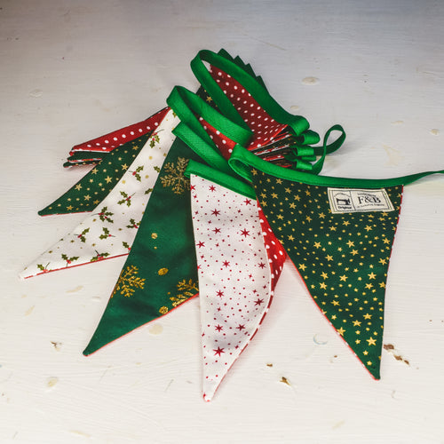Green and Red Christmas Bunting featuring stars, holly and snowflakes - handmade Christmas by F&B in Yorkshire