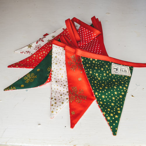 Red and Green Christmas Bunting Handmade by F&B featuring stars and snowflakes on christmas colours 3m in length