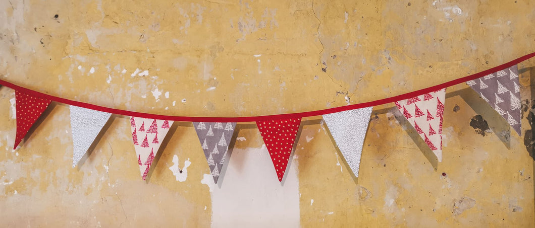 Red and gold, white and silver, tree print bunting joined with red binding makes this 2.5m of christmas bunting