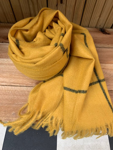 Thick winter scarf in mustard with black check pattern.
