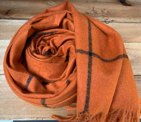 Thick winter scarf in orange with black check pattern.