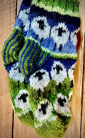 Hand knitted 100% cosy sofa socks with flock of sheep design.