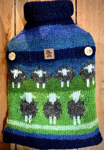 Hand knitted 100% wool Hot Water Bottle with flock of sheep design.
