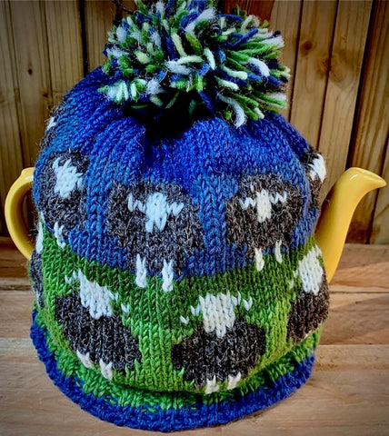 Hand knitted 100% wool tea cosy with flock of sheep