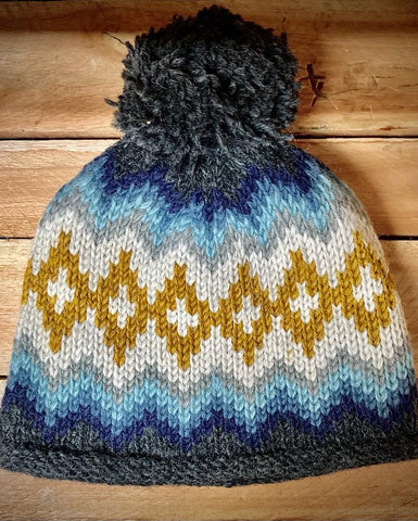 Bobble Hat with Pom in Blue Zig Zag pattern