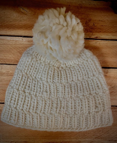 Off white colour hand knitted hat with pom