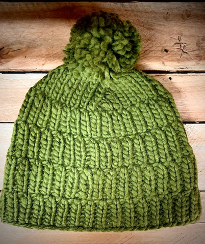 Hand knitted green hat with pom