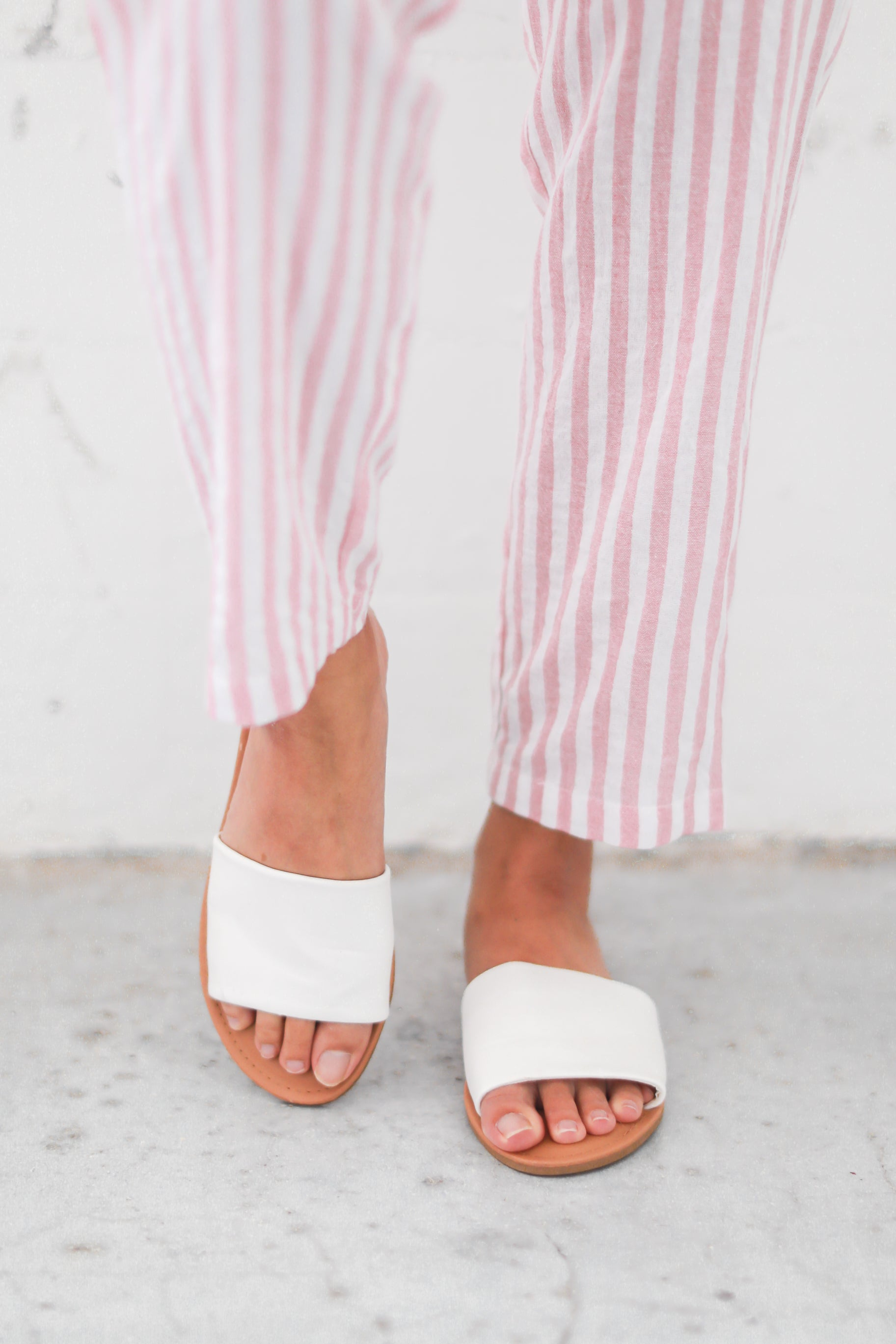 TOE THE LINE SLIP ON SANDALS