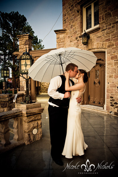 Umbrellas + wedding photos=love! Find them for rent and/or sale at www.weatherornotaccessories.com | Weather or Not for Your Guests | Rental Company | Weddings | Outdoor Events | Shawls | Blankets | Umbrellas | Fans
