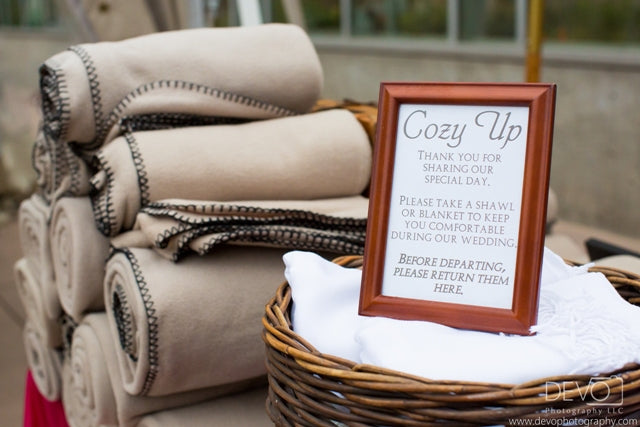 Tan fleece blankets await guests. Credit: Devo Photography