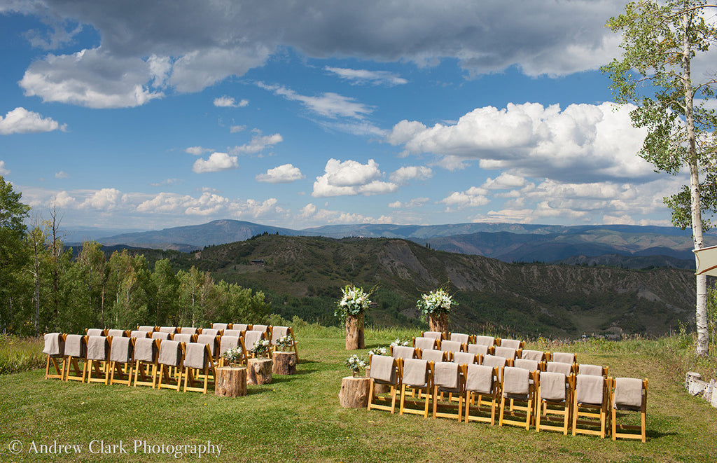 Tan fleece blankets adorn an Aspen wedding ceremony. Credit: Andrew Clark Photography