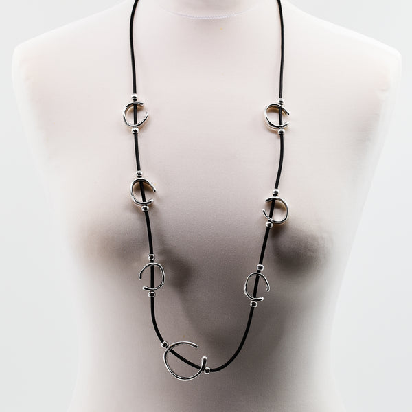 Long black leather necklace with multi organic shaped pendant