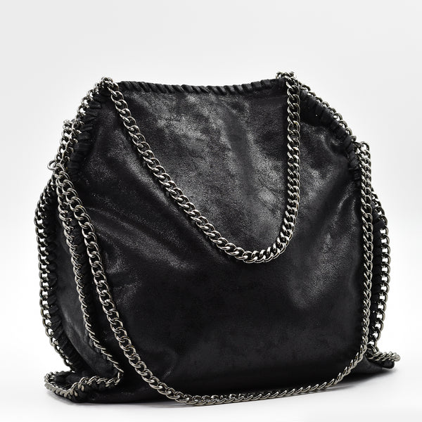 Stylish handbag with statement heavy curb chain handles