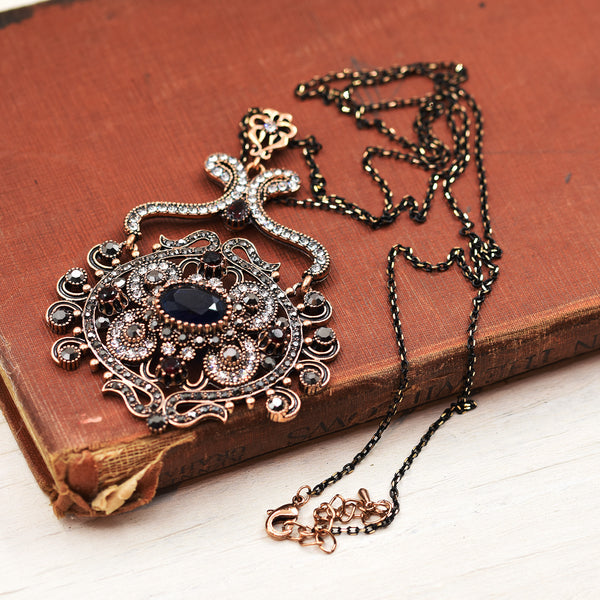 Long victoriana  necklace with circular jewelled pendant