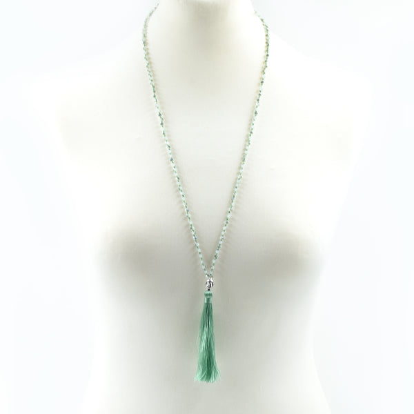 Delicate long beaded necklace with tassel pendant