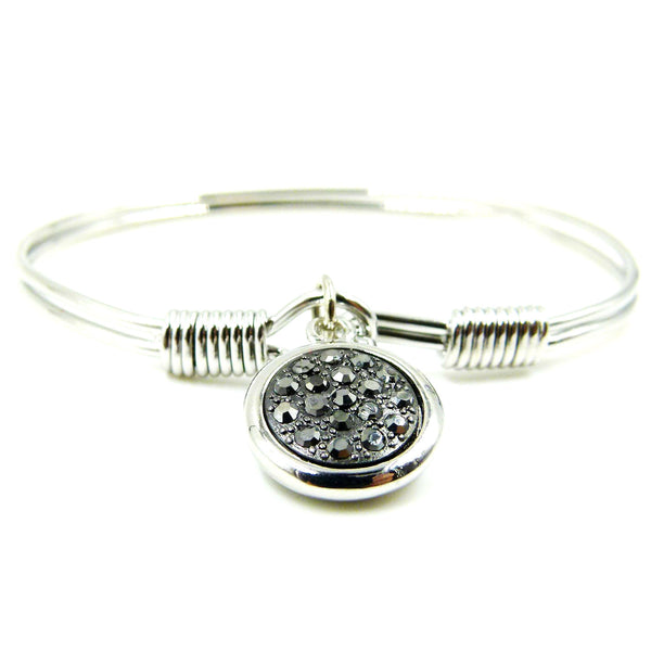 Delicate bangle with mosaic style disc charm