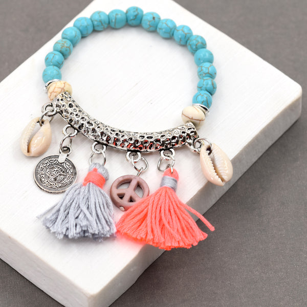 Blue beaded bracelet with multi charms