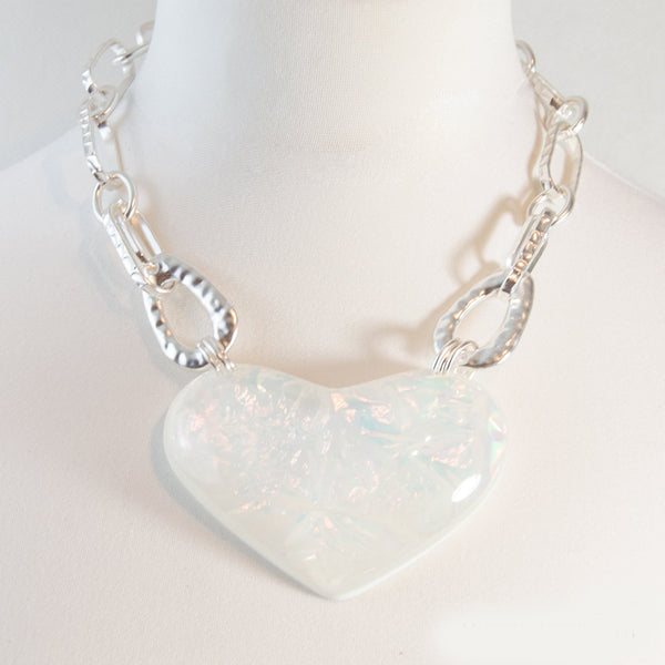Heart shape iridescent pendant on chain link necklace
