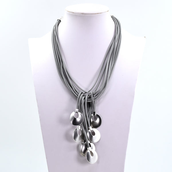 Statement necklace with wax cord and circle shape drop features
