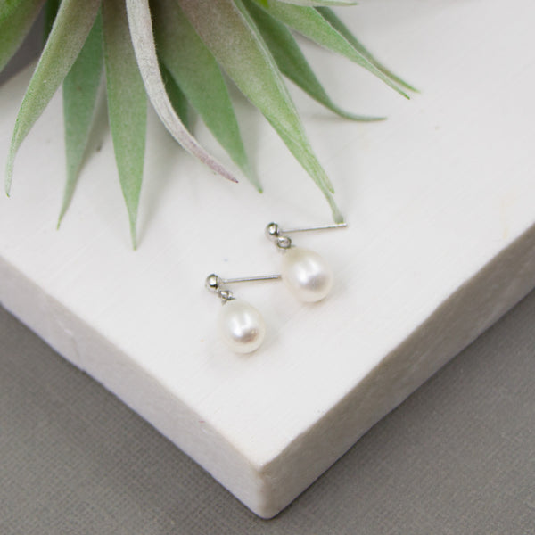 Silver drop earrings with real pearls