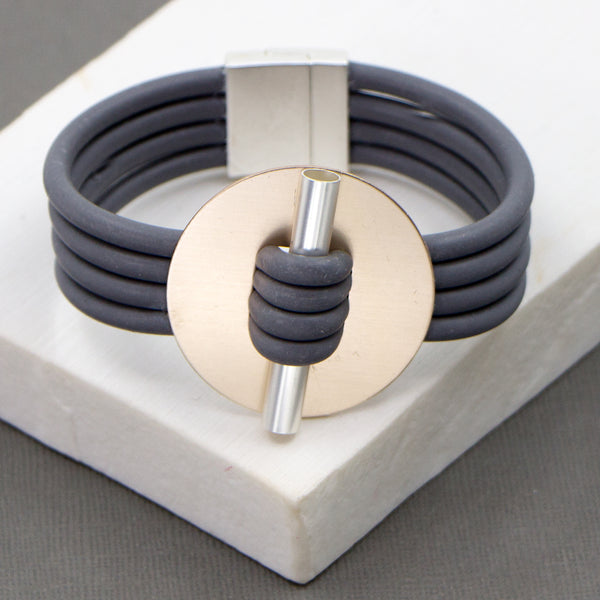 Neoprene bracelet with disc and bar detail and magnetic clasp