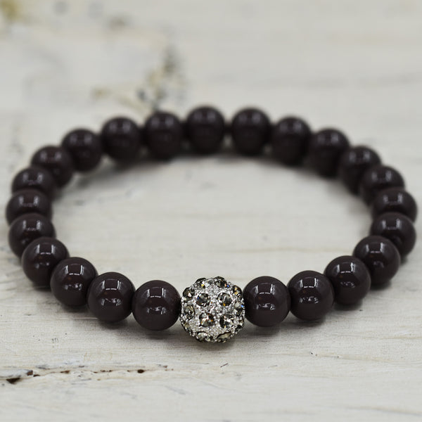 Simple stretchy bead bracelet with central diamante