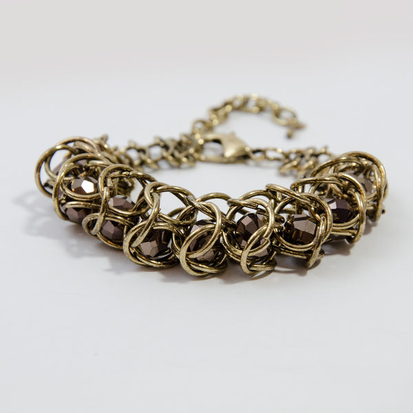 Cut glass beads encased in multi link chain bracelet