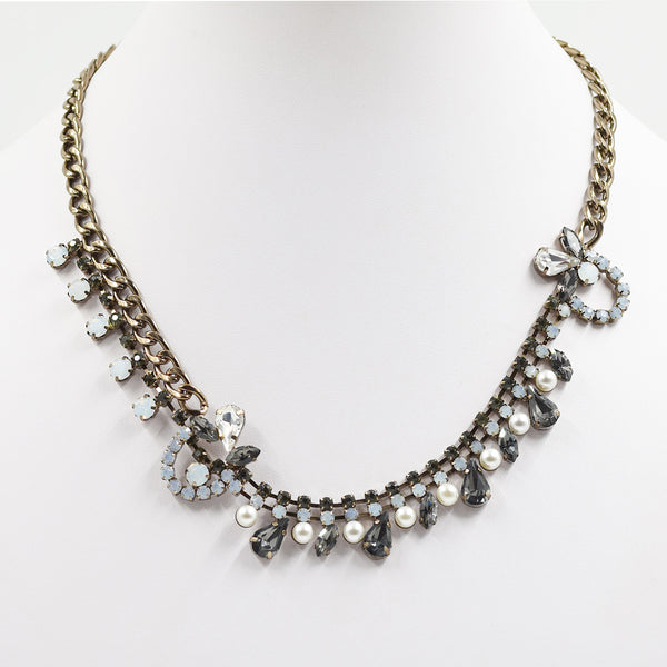 Statement necklace with multi crystal and pearl details