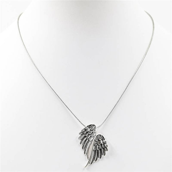 Vintage style feather pendant on snake chain