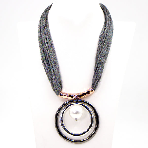 Circle and pearl pendant on short fabric necklace