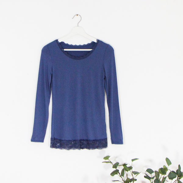 Medium size long sleeve top with lace neck and hemline