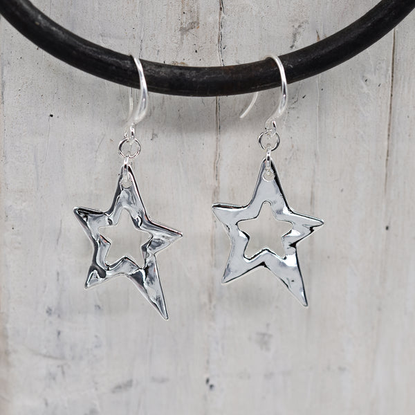 Open star fish hook earrings