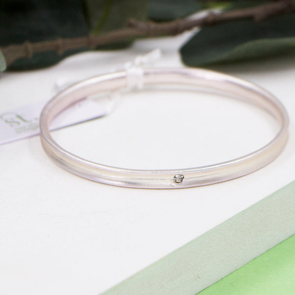 Matte silver bangle with crystal feature