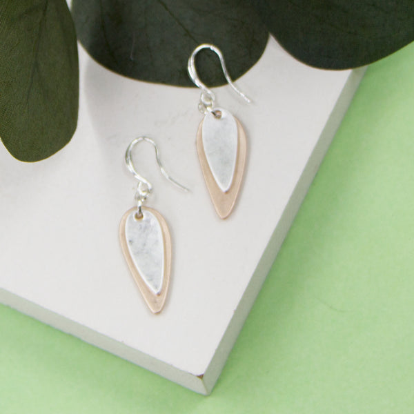 Elongated oval shape charm on fish hook earrings