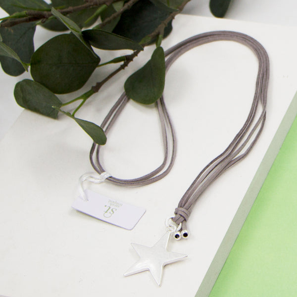 Star pendant on grey suede long necklace