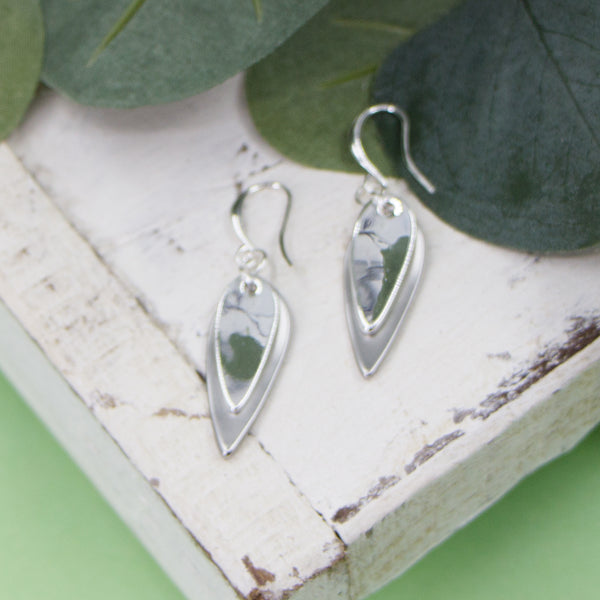 Layered oval shaped charms on fish hook earrings