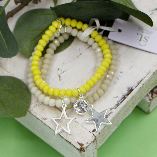 Set of three coloured beaded bracelets with crystal and star