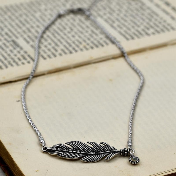 Vintage style feather pendant with crystals on short chain