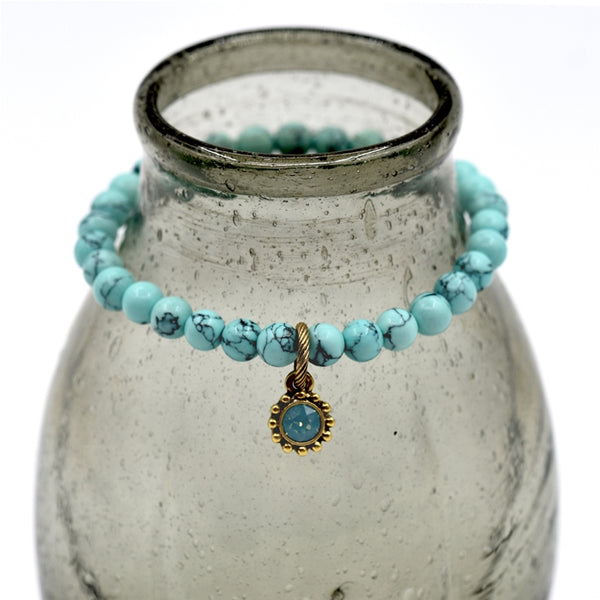 Marble effect beaded braclet with delicate opal stone drop