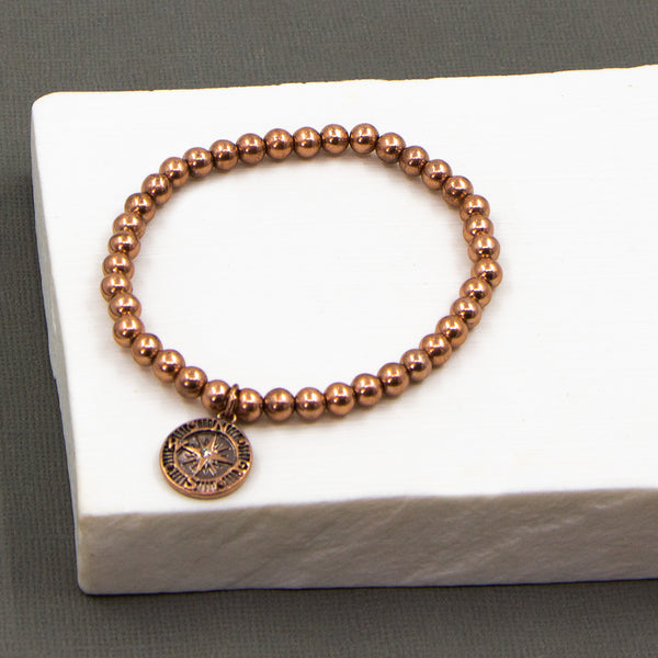 Delicate beaded bracelet with compass crystal charm