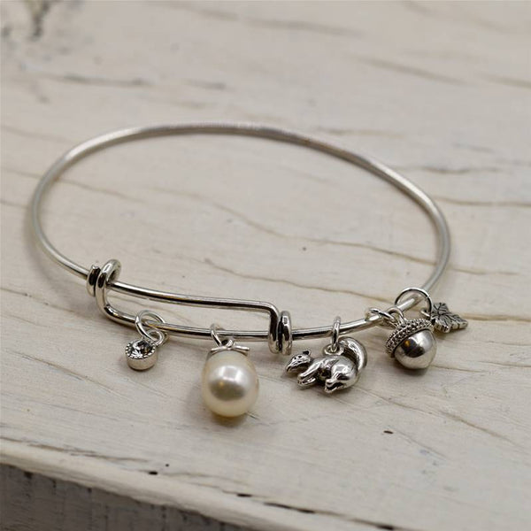 Adjustable bangle with sweet woodland charms