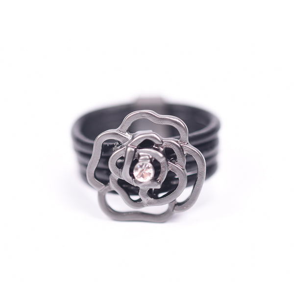 Cut out flower with crystal on leather ring