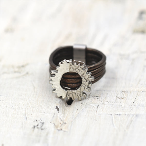 Litle cog style mix texture finish ring on multi leather