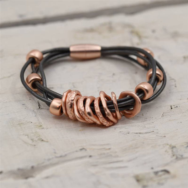 Varied little hoops on multi strand leather bracelet