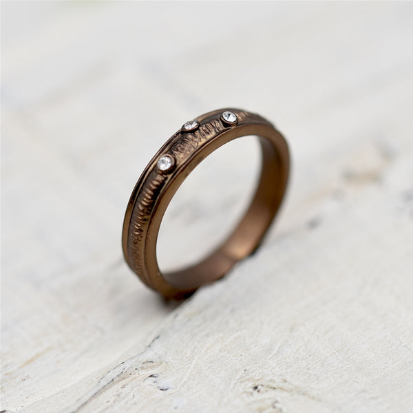 Simple ridged ring with delicate crystal detail