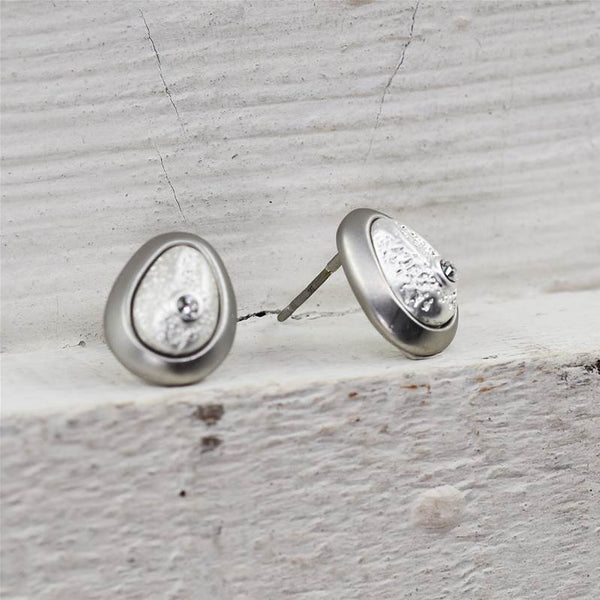 Framed egg shaped stud earrings with little crystals