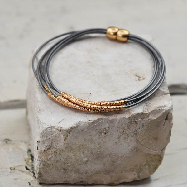 Delicate leather bracelet with fine tube components