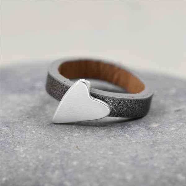 Triple layered grey ring with matte silver heart charm